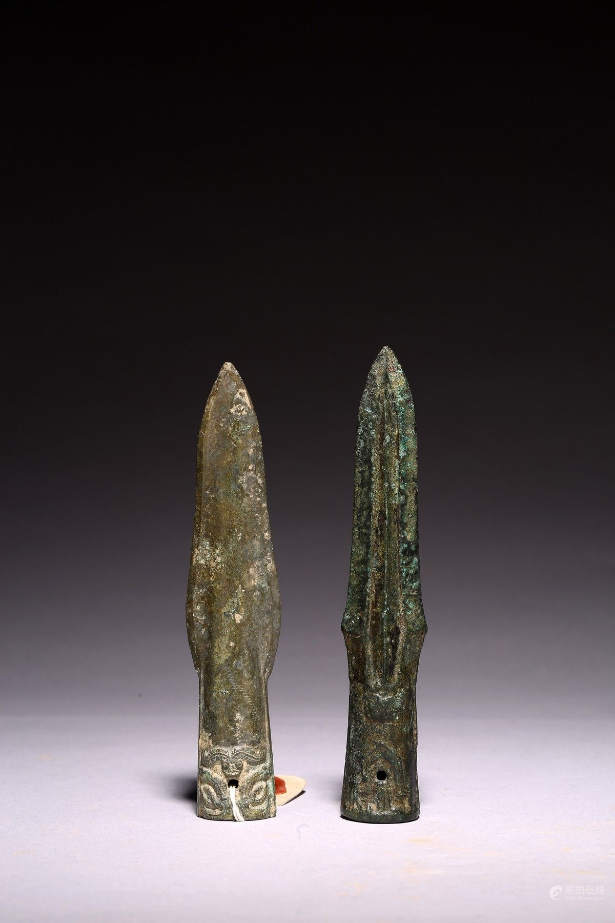 A GROUP OF TWO ARCHAIC CHINESE BRONZE SPEAR HEADS