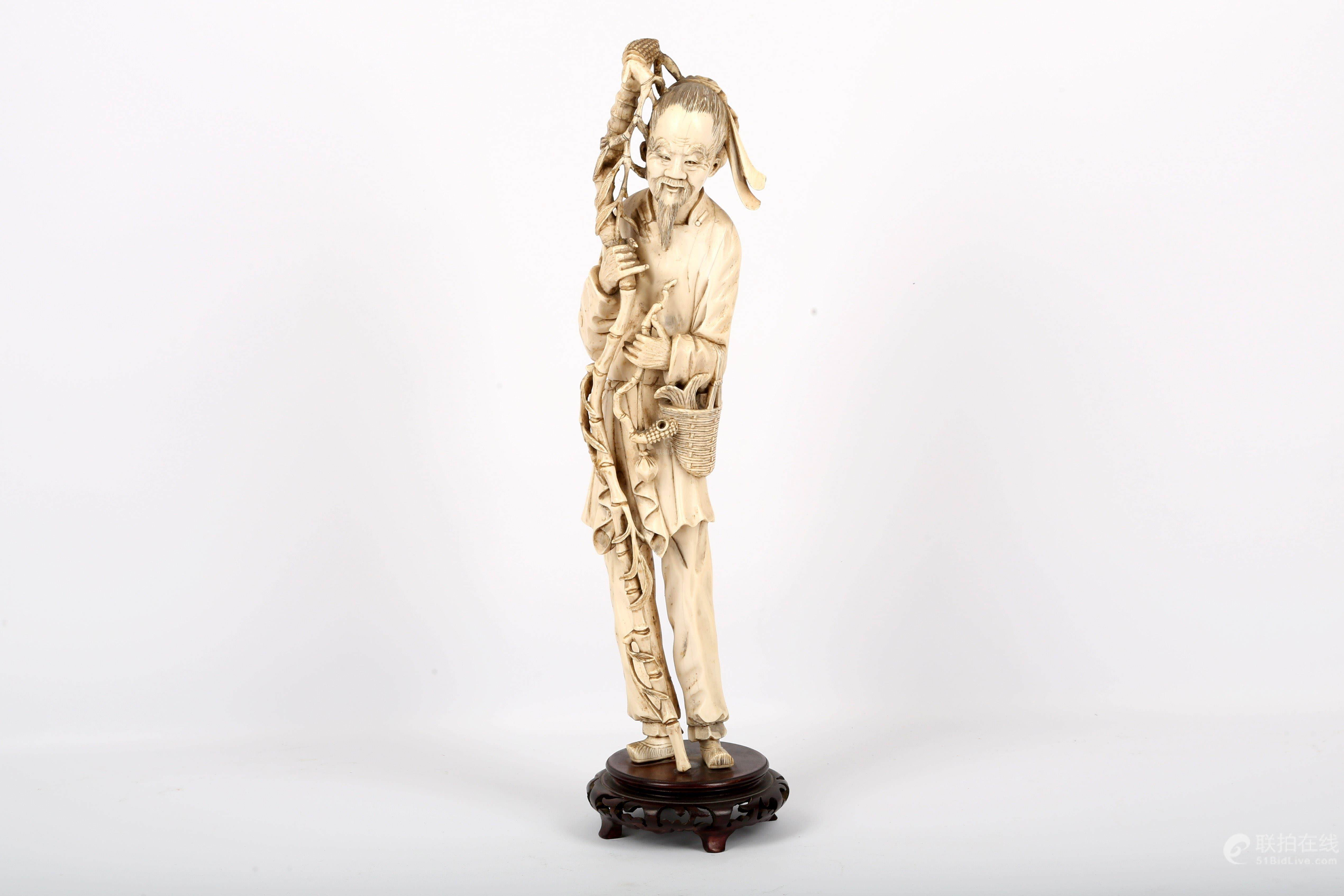 c19ccdb2f 51BidLive-  A Chinese ivory carving of a fisherman