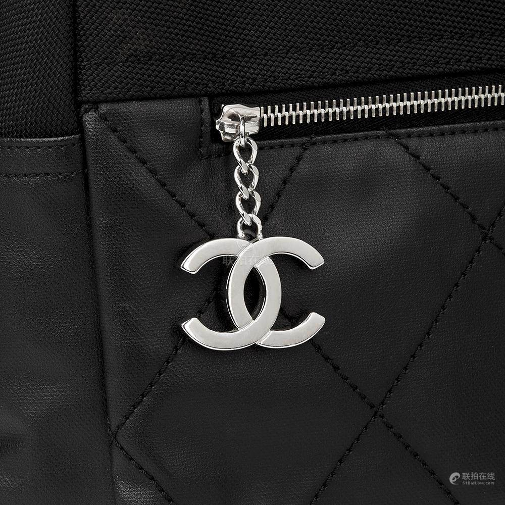0f718418d84547 51BidLive-[ Chanel Black Quilted Coated Canvas Convertible Backpack]