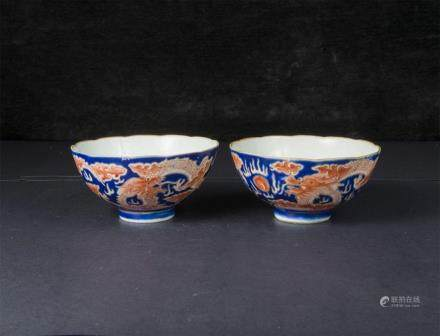 A Pair Of Iron-Red-Decorated Blue-Ground 'Dragon' Bowls