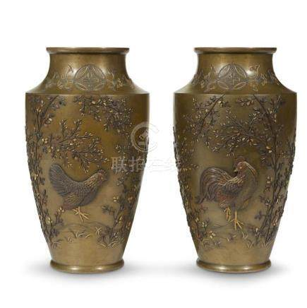 A pair of Japanese patinated bronze and mixed metal-inlaid v