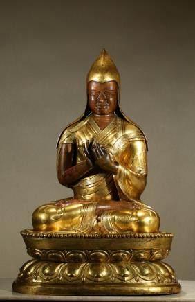 A very large gilt bronze figure of Tsongkaba
