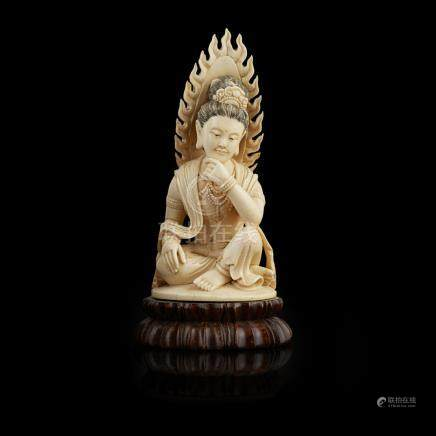 IVORY FIGURE OF A SEATED BODHISATTVAQIANLONG MARK BUT LATE 19TH/EARLY 20TH CENTURY the deity