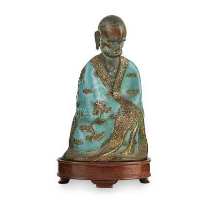CHAMPLEVÉ ENAMEL AND BRONZE MODEL OF A LUOHANQING DYNASTY, 18TH/19TH CENTURY modelled seated wearing