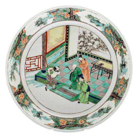 A Chinese famille verte plate decorated with an animated scene, marked,ø 35 cm
