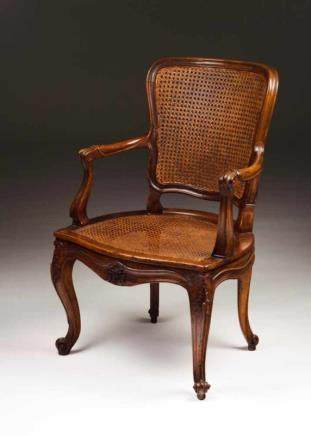 A Louis XV fauteuil Walnut Caned back and seat France, 18th century