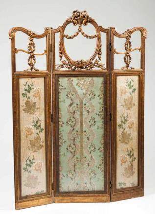 A three panel folding screen Carved and gilt wood, fabric and glass Scalloped panels decorated with