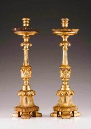 A pair of D. José style torchères Carved and gilt wood Portugal, 19th century Height: 64 cm