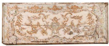 A large panel Carved and partly gilt and polychrome wood Decorated with scrolls, shell and floral