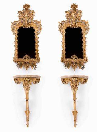 A pair of Louis XV style pier tables and mirrors Carved and gilt wood and gesso Upper part with
