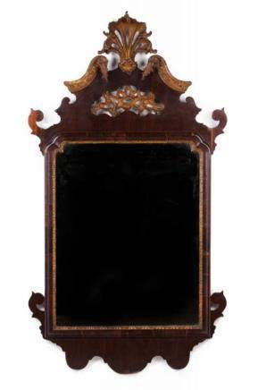 A George III mirror Rosewood veneered Carved and gilt wood decoration England, 19th century 132x72,