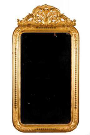 A Romantic mirror Gilt wood and gesso Decorated with beaded frieze and garlands Scalloped and