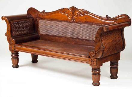 A William IV settee Rosewood and other woods with carved decoration Caned seats and backs Turned