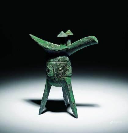 商青铜兽面纹爵