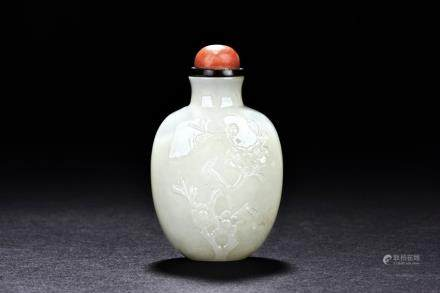 A white jade 'magpie on plum' snuff bottle