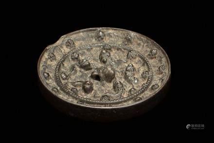 An archaic bronze 'Sea Horse' mirror