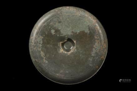 A archaic bronze mirror of plain design