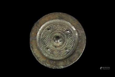 An archaic bronze 'four mythical beast' mirror