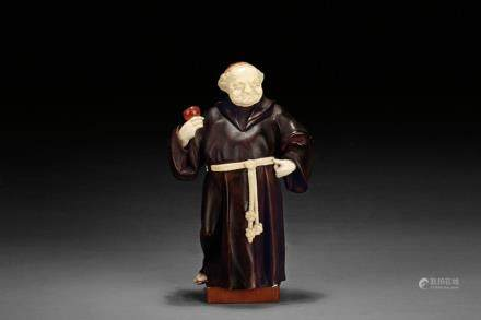 A Western rosewood and ivory monk figure