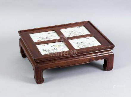 A small Chinese side table with 4 famille-rose porcelain pla