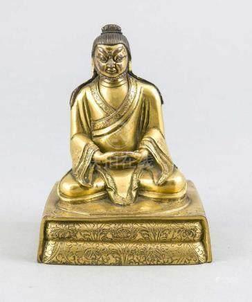 A gilt Tibeto-Chinese bronze figure, 19th c., full-round rep