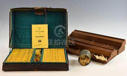 20th century Chinese yellow resin Mah-Jong set in fitted case with bone counters and four trays,