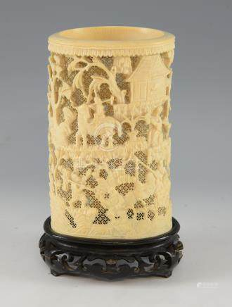 19th century Chinese relief carved ivory tusk with figures in a landscape setting, on hardwood base,