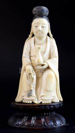 Chinese carved ivory figure of a Guan Yin, on carved wood base which bears Cornelius Gillmore