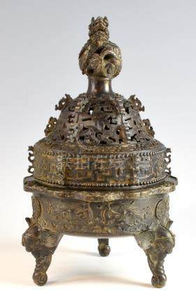 Chinese bronze censer and cover with coiled dragon finial, pierced and scrolling decoration on a