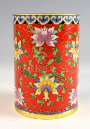 Chinese cloisonne brushpot, the red ground decorated with scrolling flowers and foliage, 12.5cm