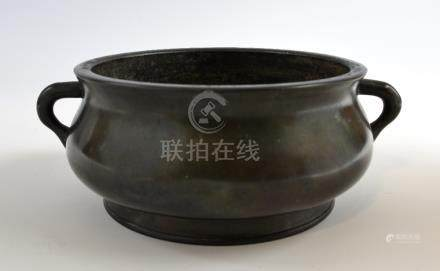 Chinese bronze twin-handled censer on round foot, raised four character mark to base, 21.5cm at