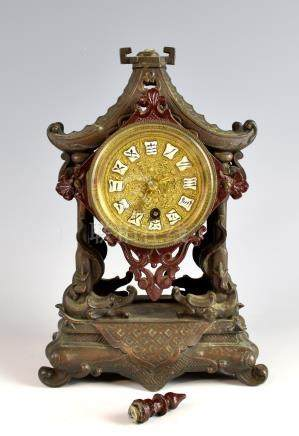 Chinese spelter clock in the form of a pagoda, with single train movement, the gilt dial with enamel