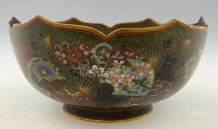 Chinese cloisonne bowl with wavy rim and decorated with numerous fans and a central panel of a