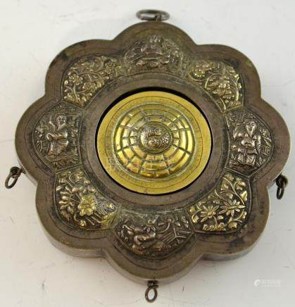 Late 18th/ early 19th century Chinese silver eight lobed pendant with embossed alternating panels of