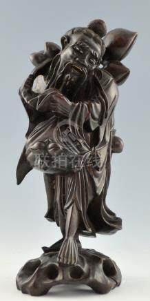 Chinese carved hardwood figure of a bearded man carrying a branch of peaches, 36cm high,PLEASE NOTE: