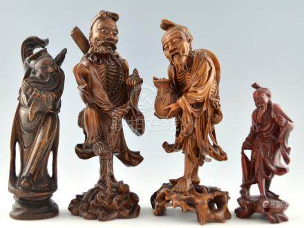 Chinese carved hardwood of a bearded man holding a bat and standing on one leg on a turtle, 33cm