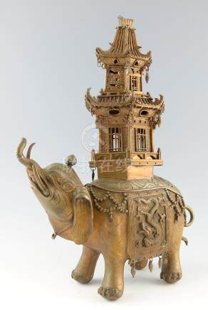 Chinese cast bronze censer in the form of an elephant with a pagoda on it's back, 50cm high,
