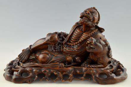Chinese hardwood carving of a man reclining with a tiger, 20cm x 40cm,PLEASE NOTE: THIS ITEM