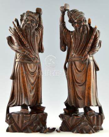 Pair of Chinese hardwood carvings of bearded robed men, 41cm high,