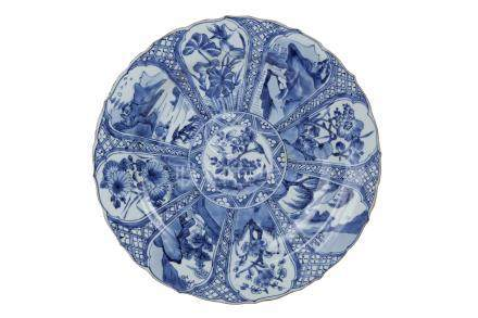 A LARGE BLUE AND WHITE DISH WITH BARBED RIMKangxi period, early 18th centur