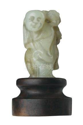 A PALE GREEN JADE CARVING OF LIU HAIQing dynasty5,3 cm highProvenance: acqu