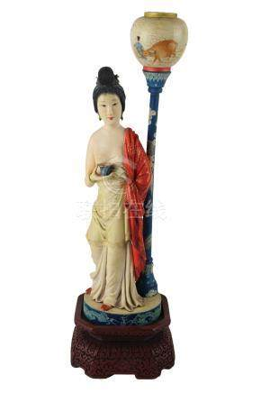 A PAINTED IVORY CARVING OF A FIGURE OF A LADY MOUNTED AS A LAMPFirst half o
