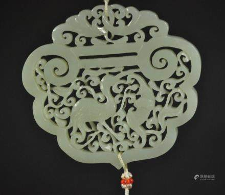 A Carved White Jade Pendant