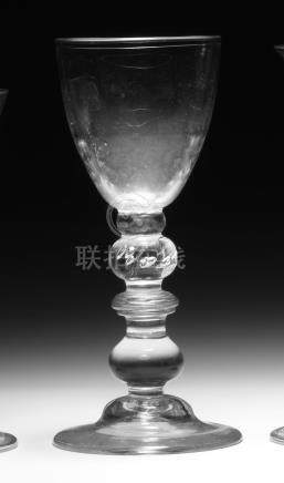A very unusual heavy baluster wine glass or goblet, circa 1720-25