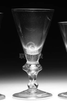 A good heavy baluster large wine glass or goblet, circa 1710-20