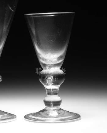 A heavy baluster wine glass, circa 1715