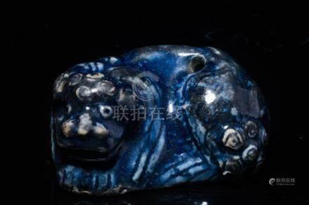 """A Blue-Glazed """"Lion"""" Pot"""