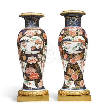 A PAIR OF JAPANESE IMARI VASES MOUNTED IN ORMOLU THE PORCELA