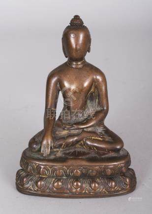 A Bronze Figure of Buddha, Tibet, circa 16th century, seated