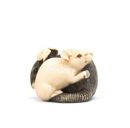 JAPANESE IVORY NETSUKE Depicting two rats with inlaid eyes
